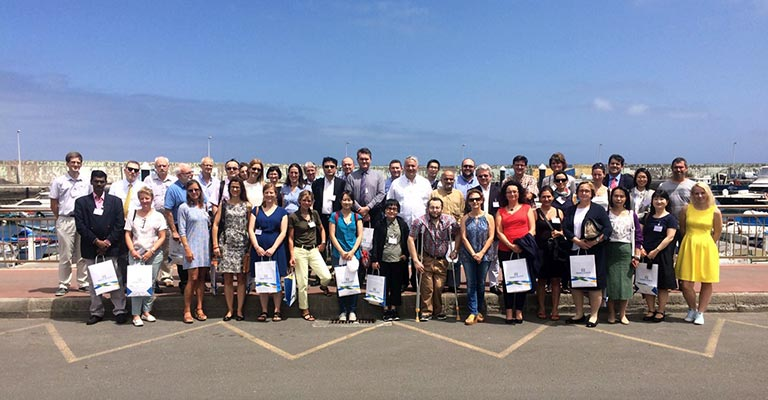Group shot of participants on the sea front